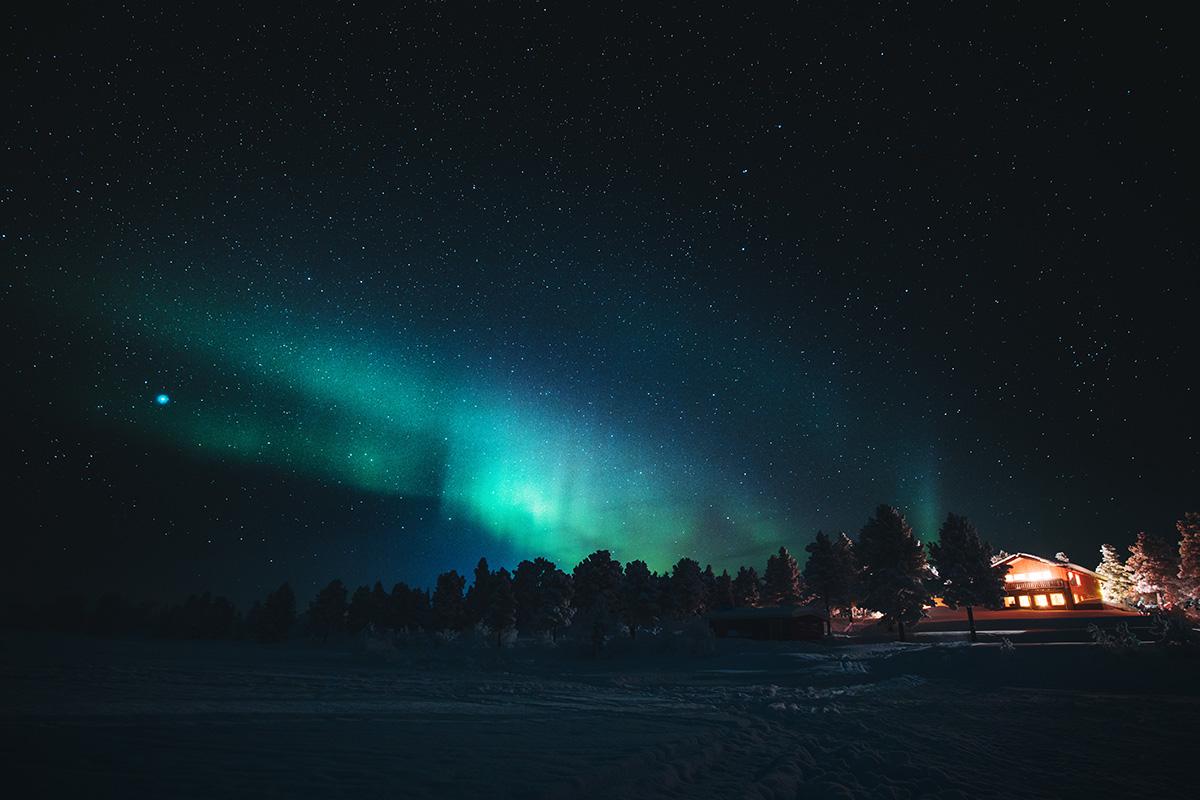 Northern lights aurora chalet Lapland Raphaelle Monvoisin
